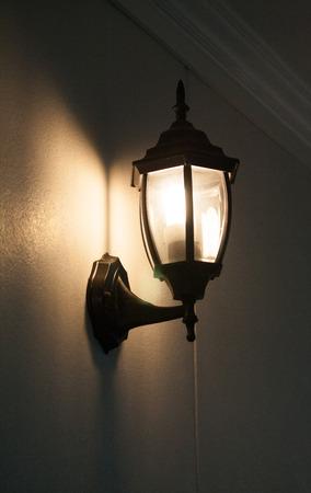Wall black lamp light yellow in night
