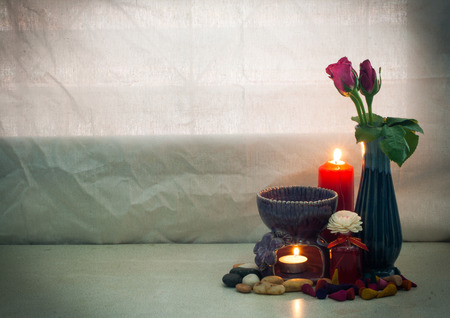 still life Pink rose in vase and aroma stove , oil , incense cone , stone in warming    concept good day or fresh , refresh photo