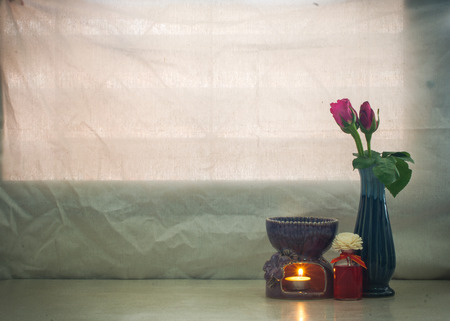 still life Pink rose in vase and aroma stove , oil in warming    concept good day or fresh , refresh photo