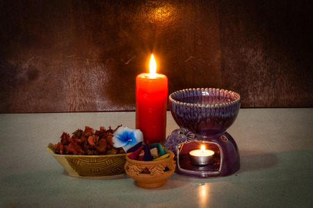 Still life aroma set on wood background with incense cone , stove , candle flower photo