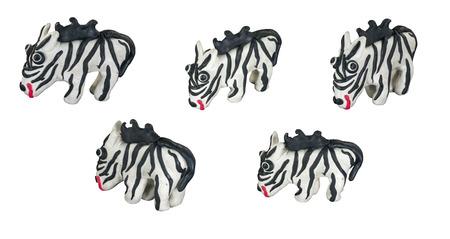 Set of white zebra made from plasticine on white background photo