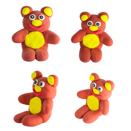 Set of cute brown bear made from plasticine with clipping path on whote photo
