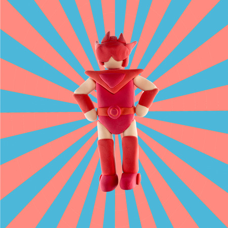 sunray: red super hero made from plasticine use for super special protect concept on sunray background