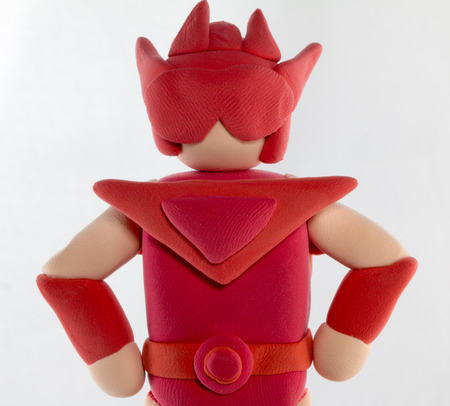 creative arts: Close up red super hero made from plasticine use for super special protect concept