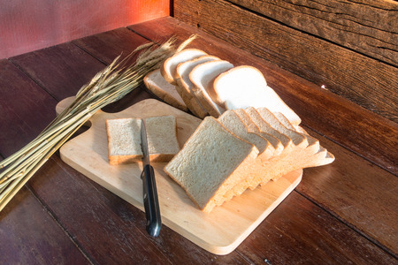 Cutting bread on wood background still life style Stock Photo