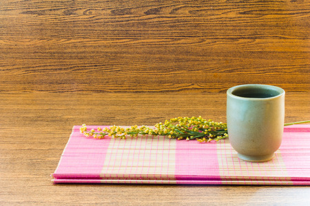 Tea cup on wooden background still life style