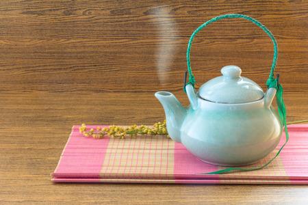 chinese tea pot: Chinese tea pot on pink bamboo mat still life style