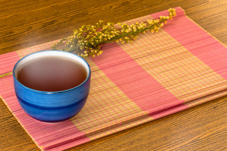 Relaxing Chinese Tea cup on bamboo mat still life style