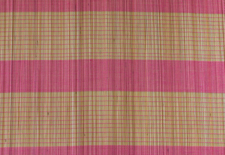 yellow and pink strip bamboo mat background Stock Photo