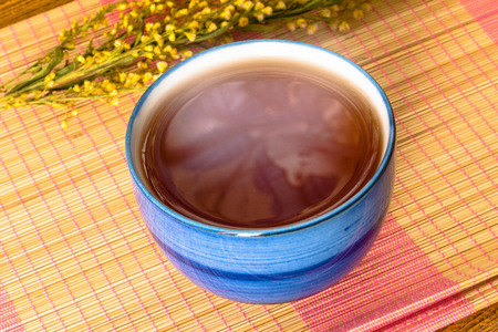 chinese tea cup: Relaxing Chinese Tea cup on bamboo mat still life style
