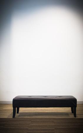 Soft bench with light like spot light Stock Photo
