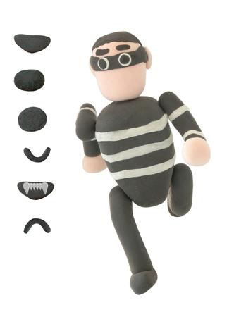 Plasticine Thief of misdaad in het uitvoeren van actie op een witte achtergrond Stockfoto