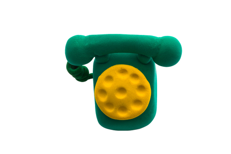 Green rotary telephone made from plasticine