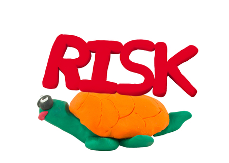 Plasticine red risk on yellow turtle concept slow risk Stock Photo