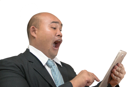 Bald businessman use tablet in motion agape in concept scared or surprise on white