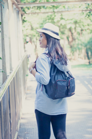 Woman with Woman with backpack in nature concept relax or happy retro style