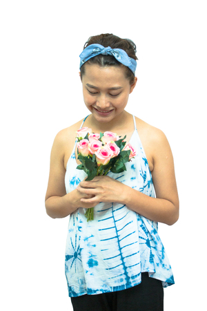 Asian woman smile and hold pink rose concept in love Stock Photo