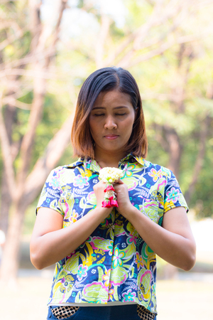 Asian Woman pray with garland