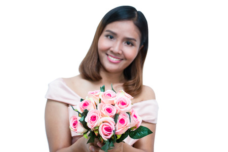 Asian woman hold pink rose on white isolated background