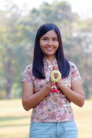 Asian girl with garland concept songkran or sawasdee or hello