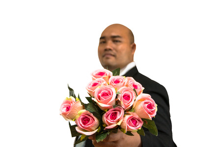 asian bald man holding pink rose in concept love or cerebrate on white