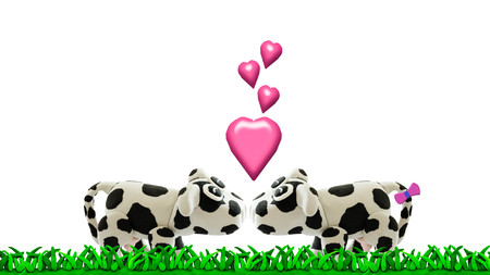 Plasticine cow in love on meadow Stock Photo