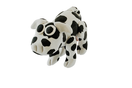 Plasticine cow on whie isolated background