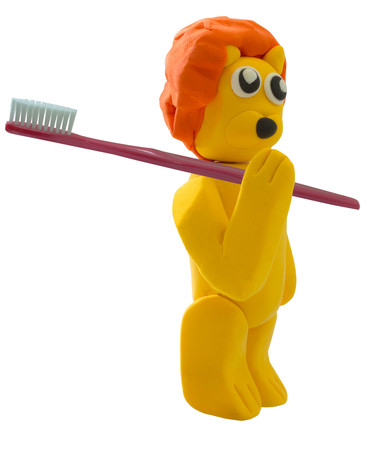 Standing lion and toothbrush in concept dentist on white
