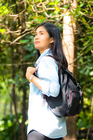 Asian traveller  backpacker  woman walk in the park or nature