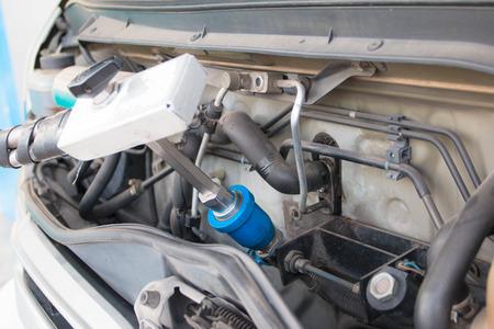 Van refuel gas in gas station Stock Photo