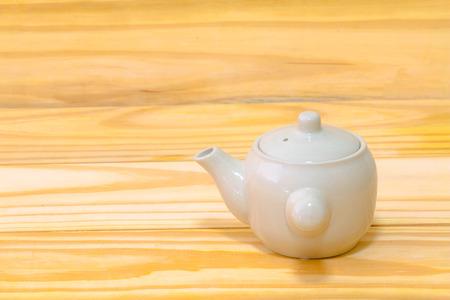 Tea pot on wood background still life art Stock Photo