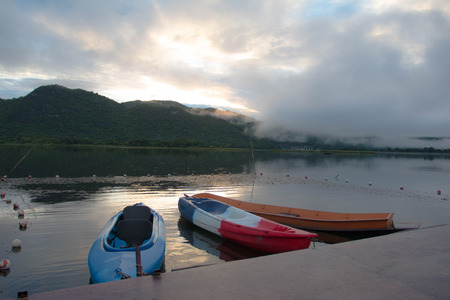 Lake view with canue in morning and fog Stock Photo