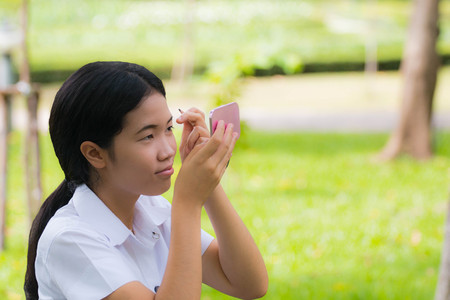 Beauty asian Student Makeup eyebrown in green park