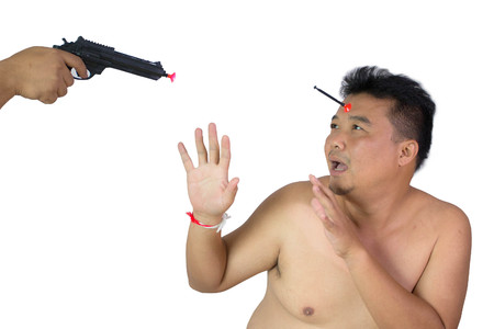 Asian fatman with hand aiming gun on his head concept murder