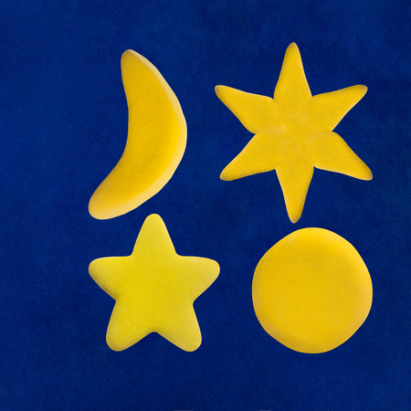 Plasticine star and moon on blue sky background Banco de Imagens