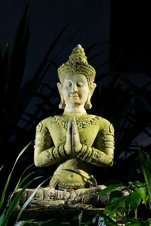 Sitting deva statue