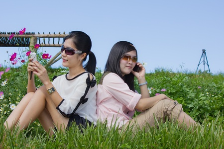 cute woman use mobile phone and look her mobile phone