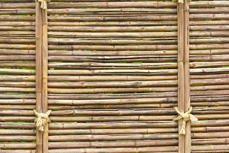 brown bamboo wall with rope