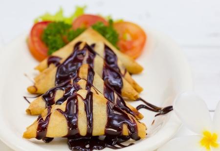 Banana Crepe with Chocolate syrup Stock Photo