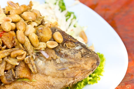 fried fish with fresh herbs and bean