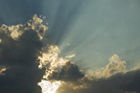 Beautiful peaceful sunset - bright sun, yellow beams photo