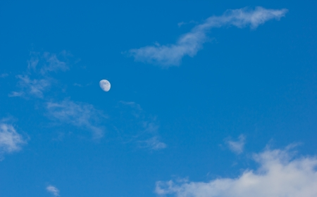 white moon in the evening with blue sky
