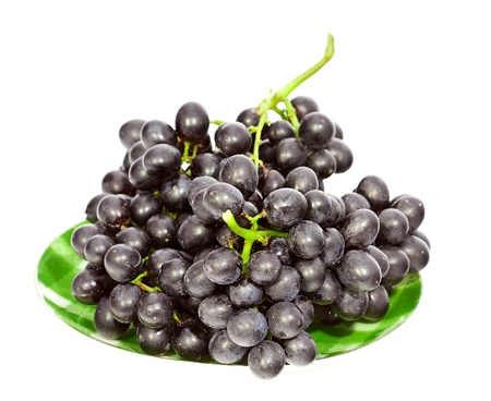 very fresh grapes isolated with dish on white background Stock Photo