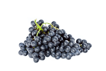 fresh bunch of ripe wine grapes isolated on white background Stock Photo