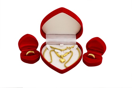 Wedding gold necklace and wedding ring in box Stock Photo