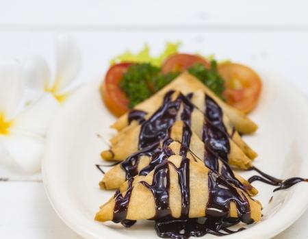 Banana Crepe with Chocolate syrup photo