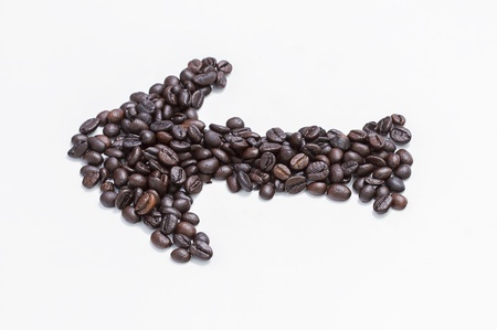 arrow coffee beans isolated on white background photo
