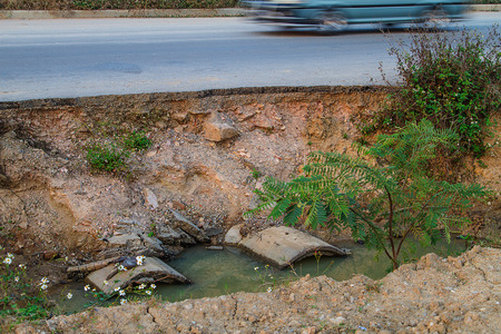 Collapse of the road. Condition of the road to water erosion