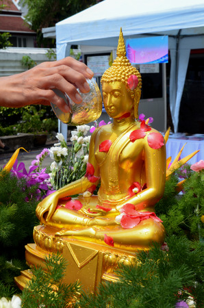 songkran: Songkran Bathing Buddha  Stock Photo