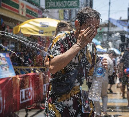 Bangkok, Thailand - April 15, 2018 : Tourists enjoy with fighting water gun on the last day of water festival in Khao San Road, Let's play with soaked together in Bangkok, super splash Editorial